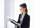 Portrait of beautiful business woman reading documents in the of Royalty Free Stock Photo