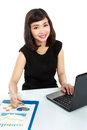 Portrait of a beautiful business woman working on her desk Stock Image