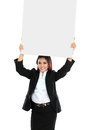 Portrait of beautiful businesswoman holding blank billboard over her head isolated on white background Stock Image