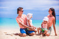Portrait beautiful caucasian family of four on tropical vacation a Stock Image