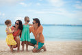 Portrait of a beautiful caucasian family on tropical vacation this image has attached release Royalty Free Stock Images