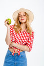Portrait of beautiful country girl with apple over white background. Royalty Free Stock Photo