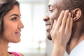 Portrait of beautiful couple looking at each other closeup african men smiling indian woman Royalty Free Stock Image