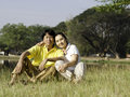 Portrait beautiful couple sitting ground park relaxing Royalty Free Stock Image