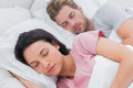 Portrait of a beautiful couple sleeping in bed Royalty Free Stock Photo