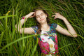 Portrait of beautiful cute girl sleeping in high grass closeup Royalty Free Stock Photo