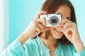 Portrait of a beautiful cute teen girl with digital photo camera close up Stock Image