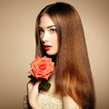 Portrait of beautiful dark haired woman with flowers fashion photo Royalty Free Stock Photos