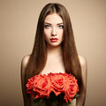 Portrait of beautiful dark haired woman with flowers fashion photo Stock Photo