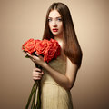 Portrait of beautiful dark haired woman with flowers fashion photo Stock Photography