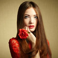 Portrait of beautiful dark haired woman with flowers fashion photo Royalty Free Stock Photo