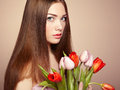 Portrait of beautiful dark haired woman with flowers fashion photo Royalty Free Stock Photography