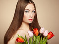 Portrait of beautiful dark haired woman with flowers fashion photo Stock Images