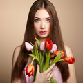 Portrait of beautiful dark haired woman with flowers fashion photo Stock Photos