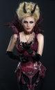 Portrait of beautiful devil woman in dark sexy dress