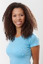 Portrait of beautiful ethnic girl smiling in light blue t shirt Royalty Free Stock Images