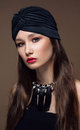 Portrait Beautiful fashion east woman. Indian arabic girl with black turban. Royalty Free Stock Photo