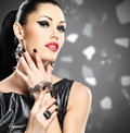 Portrait of a beautiful fashion woman with bright makeup black nails and pretty sexy face glamour girl posing at studio over Royalty Free Stock Photography