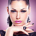 Portrait of a beautiful fashion woman with bright makeup black nails and pretty sexy face glamour girl posing at studio over Stock Images