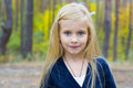 Portrait of beautiful five year old girl outdoors Stock Photos