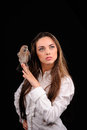 Portrait of beautiful girl with bird on the hand Royalty Free Stock Photo