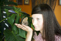 Portrait of beautiful girl with butterfly Royalty Free Stock Photo