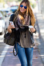 Portrait of beautiful girl drinking coffee and using her mobile Royalty Free Stock Photo