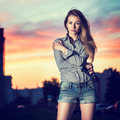 Portrait of beautiful girl in evening city embracing herself urban fashion concept copy space Royalty Free Stock Images