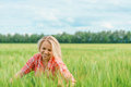 Portrait of beautiful girl in green field Royalty Free Stock Photo