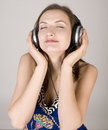 Portrait of beautiful girl in headphones singing a song close up Stock Photos