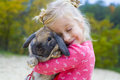 Portrait of beautiful girl with rabbit five year old embraces the favourite Royalty Free Stock Image