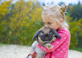 Portrait of beautiful girl with rabbit five year old embraces the favourite Stock Photos