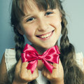 Portrait of the beautiful girl a with a red bow Royalty Free Stock Image