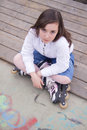 Portrait of beautiful girl with skates in the park Stock Photo