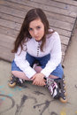 Portrait of beautiful girl with skates in the park Royalty Free Stock Photos