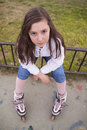 Portrait of beautiful girl with skates in the park Royalty Free Stock Images