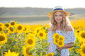Portrait of the beautiful girl with a sunflowers Royalty Free Stock Photo
