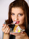 Portrait of beautiful girl tries a pie slice Stock Image