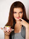 Portrait of beautiful girl tries a pie slice Royalty Free Stock Images