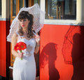 Portrait of a beautiful girl with umbrella standing in front the tram Royalty Free Stock Photo