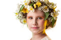 Portrait of a beautiful girl wearing flowers hat. Stock Photography