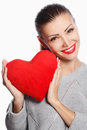 Portrait of beautiful gorgeous woman with glamour bright makeup and red heart in hand love valentines day holding smiling cute Royalty Free Stock Photography