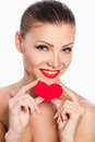 Portrait of beautiful gorgeous woman with glamour bright makeup and red heart in hand love valentines day holding smiling cute Royalty Free Stock Photos