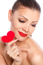Portrait of beautiful gorgeous woman with glamour bright makeup and red heart in hand love valentines day holding smiling cute Stock Photography