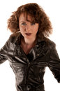 Portrait of a beautiful gothic woman in black leather jacket studio Stock Image