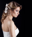 Portrait of beautiful happy gentle women bride in a white wedding dress c beautiful salon wedding hair with white flowers in her Royalty Free Stock Photo