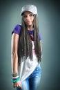 Portrait of beautiful happy girl with dreadlocks in cap music concept Stock Photo