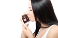 Portrait of a beautiful happy pregnant woman, kissing an ultrasound photo of her unborn baby Royalty Free Stock Photo