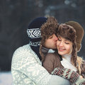 Portrait of a beautiful happy young couple in love sunny winter day Royalty Free Stock Photography