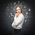 A portrait of a beautiful lady with questioning expression who is looking the best solution for the business problem chalk Stock Image